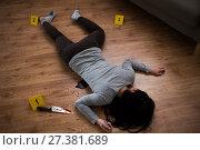 Купить «dead woman body lying on floor at crime scene», фото № 27381689, снято 5 мая 2017 г. (c) Syda Productions / Фотобанк Лори