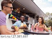 Купить «happy friends with drinks eating at food truck», фото № 27381697, снято 1 августа 2017 г. (c) Syda Productions / Фотобанк Лори