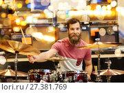 Купить «male musician playing cymbals at music store», фото № 27381769, снято 11 декабря 2014 г. (c) Syda Productions / Фотобанк Лори