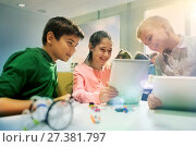 Купить «kids with tablet pc programming at robotics school», фото № 27381797, снято 23 октября 2016 г. (c) Syda Productions / Фотобанк Лори