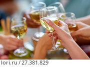 Купить «hands clinking wine glasses», фото № 27381829, снято 5 октября 2017 г. (c) Syda Productions / Фотобанк Лори