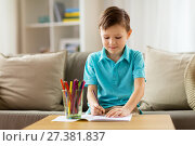 Купить «boy with notebook and pencils drawing at home», фото № 27381837, снято 4 ноября 2017 г. (c) Syda Productions / Фотобанк Лори