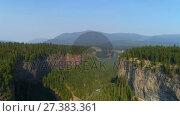 Купить «Aerial of beautiful cliff and forest 4k», видеоролик № 27383361, снято 19 июля 2019 г. (c) Wavebreak Media / Фотобанк Лори