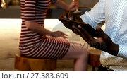 Купить «Man using his tablet while friends interacting in background 4K 4k», видеоролик № 27383609, снято 11 июля 2020 г. (c) Wavebreak Media / Фотобанк Лори