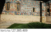 Купить «Image of frescoes of church in Sucevita Monastery on Bucovina in Romania.», видеоролик № 27385409, снято 7 октября 2017 г. (c) Яков Филимонов / Фотобанк Лори