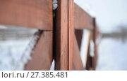 Купить «Rustic wooden fence in country style close-up. Winter, snow, suburban life», видеоролик № 27385481, снято 13 января 2018 г. (c) Mikhail Erguine / Фотобанк Лори