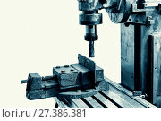 Купить «Old industrial milling machine on a white background», фото № 27386381, снято 11 июля 2015 г. (c) Евгений Ткачёв / Фотобанк Лори