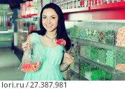 Купить «Pretty girl in sweets store picks up candies in bag», фото № 27387981, снято 25 апреля 2017 г. (c) Яков Филимонов / Фотобанк Лори