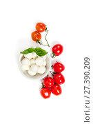 Купить «Fresh Cherry Tomatoes (mini) and Mozzarella cheese on a clean white background. Isolated.», фото № 27390209, снято 14 января 2018 г. (c) Olesya Tseytlin / Фотобанк Лори