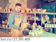 Купить «Male artisan in ceramics workshop», фото № 27391409, снято 23 марта 2019 г. (c) Яков Филимонов / Фотобанк Лори