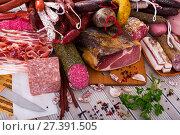 Купить «Variety of meats on table», фото № 27391505, снято 18 октября 2018 г. (c) Яков Филимонов / Фотобанк Лори