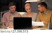 Купить «business team with laptop working at night office», видеоролик № 27398513, снято 14 декабря 2017 г. (c) Syda Productions / Фотобанк Лори