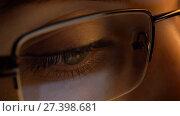 Купить «close up of woman in glasses looking at screen», видеоролик № 27398681, снято 4 января 2018 г. (c) Syda Productions / Фотобанк Лори