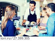 Waiter showing hospitality and serving visitors. Стоковое фото, фотограф Яков Филимонов / Фотобанк Лори
