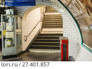 Купить «Paris, France. One of many exiting Stairs and Escalator from the Porte de Clignancourt Subway Station Platform. Subway stations are designed and build to process a huge number of commuters.», фото № 27401857, снято 11 ноября 2017 г. (c) age Fotostock / Фотобанк Лори