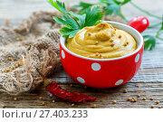 Купить «Mustard sauce and parsley in red bowl closeup», фото № 27403233, снято 15 января 2017 г. (c) Марина Сапрунова / Фотобанк Лори