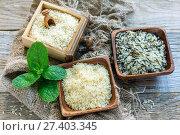 Купить «Different varieties of rice in a wooden bowl», фото № 27403345, снято 17 декабря 2016 г. (c) Марина Сапрунова / Фотобанк Лори