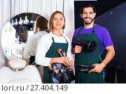Купить «Woman makeup artist and man hairdresser in the salon», фото № 27404149, снято 23 сентября 2018 г. (c) Яков Филимонов / Фотобанк Лори