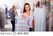 Купить «Two women selecting sleepwear in store», фото № 27404465, снято 8 июля 2020 г. (c) Яков Филимонов / Фотобанк Лори