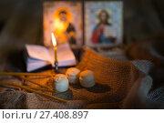 Купить «andle against the background of orthodox icons», фото № 27408897, снято 22 декабря 2017 г. (c) Типляшина Евгения / Фотобанк Лори