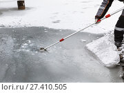 Купить «Man in special clothes collecting samples of water potentially contaminated by toxic material, in winter on the lake, in coal mine», фото № 27410505, снято 22 декабря 2017 г. (c) Сергей Тимофеев / Фотобанк Лори