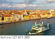 Купить «Italy. Venice. Top view of the Dorsoduro district, Church of San Trovaso, embankment Zattere and car ferry on the Giudecca Channel at the Sunset», фото № 27411385, снято 2 октября 2016 г. (c) Виктория Катьянова / Фотобанк Лори