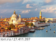 Купить «Italy. Venice. Top view of the Dorsoduro district, Cathedral of Santa Maria della Salute, embankment Zattere and the Piazzetta San Marco, the Doge's Palace, Bell Tower Companile in the rays of the setting sun», фото № 27411397, снято 2 октября 2016 г. (c) Виктория Катьянова / Фотобанк Лори