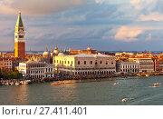 Купить «Italy. Venice. Top view of the Piazzetta San Marco, the Doge's Palace and Bell Tower Companile at sunset. Many tourists on the promenade of San Marco», фото № 27411401, снято 2 октября 2016 г. (c) Виктория Катьянова / Фотобанк Лори
