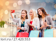 Купить «Women with smartphones shopping and taking selfie», фото № 27420553, снято 3 ноября 2014 г. (c) easy Fotostock / Фотобанк Лори