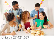 Купить «Happy friends or team eating at office party», фото № 27421637, снято 3 сентября 2017 г. (c) easy Fotostock / Фотобанк Лори