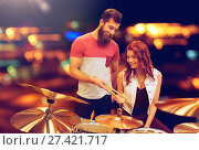 Купить «Man and woman with drum kit at music store», фото № 27421717, снято 11 декабря 2014 г. (c) easy Fotostock / Фотобанк Лори