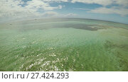 Купить «Aerial view of Bohol coast Island. Aerial. Flight is close above the water. Fisheye view. Philippines.», видеоролик № 27424293, снято 20 января 2018 г. (c) Mikhail Davidovich / Фотобанк Лори
