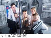 Купить «Ordinary family is passing of quest room», фото № 27425461, снято 3 августа 2017 г. (c) Яков Филимонов / Фотобанк Лори