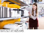 Купить «delighted young woman with purchase», фото № 27425645, снято 12 декабря 2017 г. (c) Яков Филимонов / Фотобанк Лори