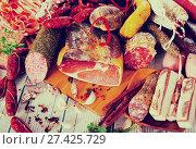 Купить «Variety of meats on table», фото № 27425729, снято 18 октября 2018 г. (c) Яков Филимонов / Фотобанк Лори