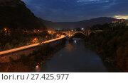 Купить «Ночной вид на дорогу с огнями машин, горы и мост через реку Кура, Грузия, Тбилиси», фото № 27425977, снято 30 сентября 2017 г. (c) Яна Королёва / Фотобанк Лори