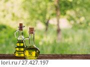 Купить «oil on wooden table outdoor», фото № 27427197, снято 29 мая 2017 г. (c) Майя Крученкова / Фотобанк Лори