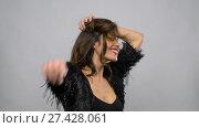 Купить «happy smiling beautiful young woman dancing», видеоролик № 27428061, снято 11 января 2018 г. (c) Syda Productions / Фотобанк Лори