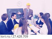 Купить «Group of engineers discussing business project», фото № 27428709, снято 7 декабря 2019 г. (c) Яков Филимонов / Фотобанк Лори