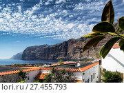 Купить «Los gigantes cliffs and village in south tenerife island spain», фото № 27455793, снято 24 января 2018 г. (c) age Fotostock / Фотобанк Лори