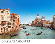 Купить «Venice, the Grand canal, the Cathedral of Santa Maria della Salute and gondolas with tourists», фото № 27460413, снято 19 апреля 2017 г. (c) Наталья Волкова / Фотобанк Лори