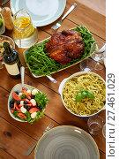 Купить «pasta, vegetable salad and roast chicken on table», фото № 27461029, снято 5 октября 2017 г. (c) Syda Productions / Фотобанк Лори