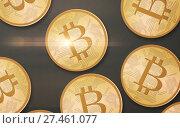 Купить «gold bitcoins over gray background from top», фото № 27461077, снято 16 июля 2018 г. (c) Syda Productions / Фотобанк Лори