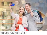 Купить «happy couple with smartphone taking selfie in mall», фото № 27461213, снято 10 ноября 2014 г. (c) Syda Productions / Фотобанк Лори
