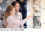 Купить «couple looking to shopping window at jewelry store», фото № 27461481, снято 10 ноября 2014 г. (c) Syda Productions / Фотобанк Лори