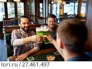 Купить «male friends drinking green beer at bar or pub», фото № 27461497, снято 22 апреля 2015 г. (c) Syda Productions / Фотобанк Лори