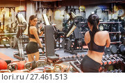 woman with smartphone taking mirror selfie in gym. Стоковое фото, фотограф Syda Productions / Фотобанк Лори