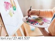 Купить «artist with palette painting at art studio», фото № 27461537, снято 1 июня 2017 г. (c) Syda Productions / Фотобанк Лори