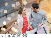 Купить «happy young couple with shopping bags in mall», фото № 27461645, снято 10 ноября 2014 г. (c) Syda Productions / Фотобанк Лори