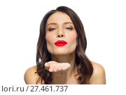 Купить «beautiful woman with red lipstick blowing air kiss», фото № 27461737, снято 5 января 2018 г. (c) Syda Productions / Фотобанк Лори